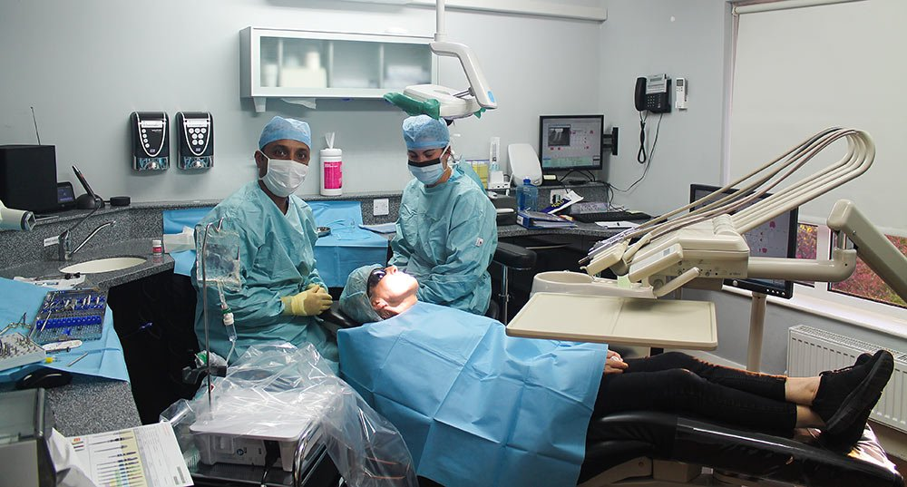 Dentist, nurse and patient, implant surgery